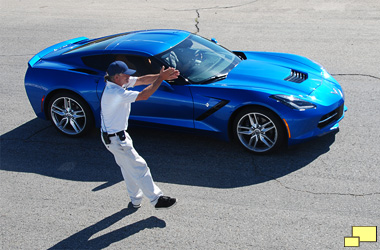 2016 Chevrolet Corvette w/Z51 in Laguna Blue Tintcoat At Willow Springs International Raceway with a course worker