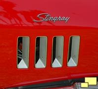 Four vertical front fender louvers below Stingray emblem on 1969 Corvette