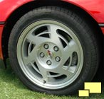 1990 Corvette wheel with exposed lug nuts